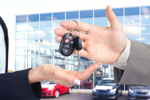 Auto Dealerships Handing Keys Competition Marketing Consultant