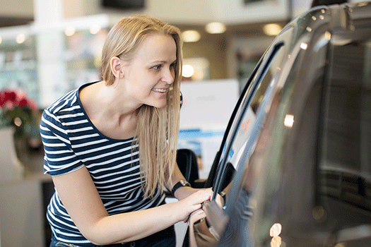 Lady Looking at Car for Prepaid Maintenance Program